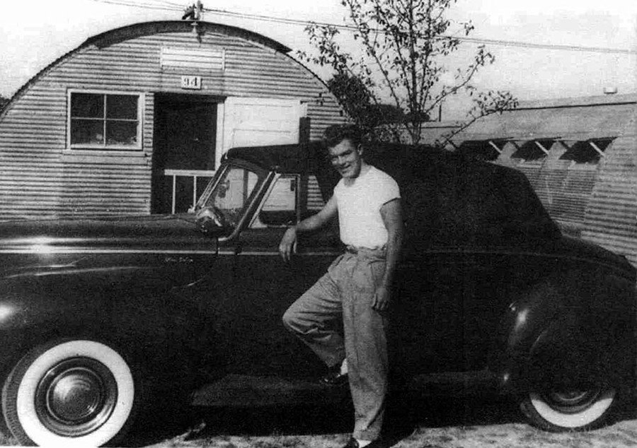 A young Dave Holls standing next to an early Ford model Deans Garage RESIZED 1