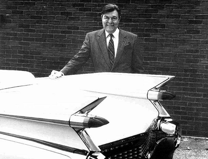 Dave Holls standing next to a 1959 Cadillac General Motors 3