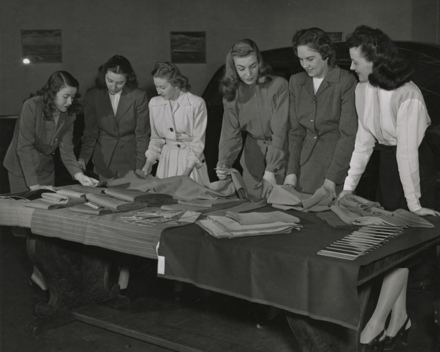 Women examining upholstery at Ford 1950 NAHC RESIZED 3