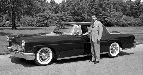 William Clay Ford standing with a 1956 Continental Ford Motor Company Archives 2