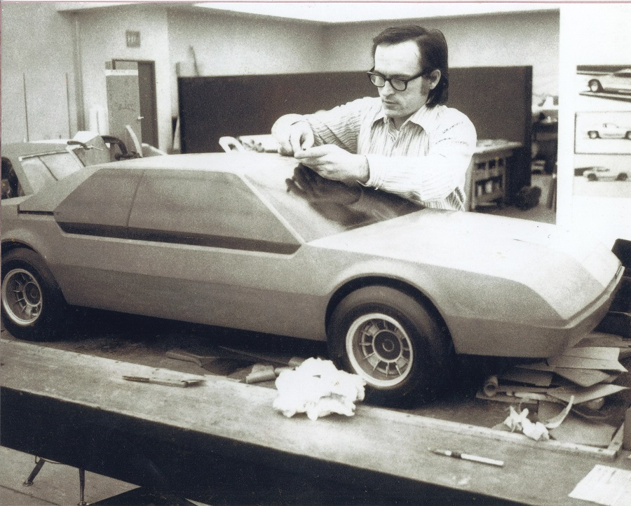Ronald Konopka with a clay model of a 1975 Chrysler turbine car proposal Konopka Collection